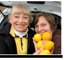 Karen Moss and Rebecca holding lemons